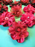 Red artificial fabric flowers Stock Photos