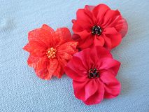 Red artificial fabric flowers stock image