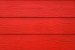 Red artificial wood texture background Royalty Free Stock Photography
