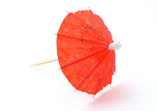 Red asian cocktail umbrella on white royalty free stock images