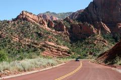 Red asphalt. Two lane road Stock Image