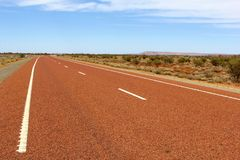Red abandoned highway in the countryside, Australia Stock Photo