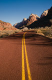 Red Asphalt Roadway Redrock Canyon Utah Backroads. A beautiful clear day on the road in Zion National Park stock photo
