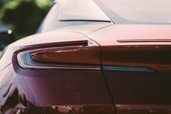Red Aston Martin DB11 rear light Royalty Free Stock Image