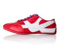 Red athletic sneaker with purple laces Royalty Free Stock Photo