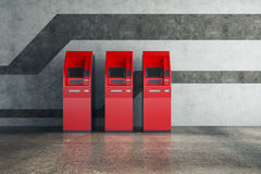 Red ATM in concrete interior Stock Photography