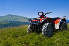 Red atv on highlands- quad. Red atv on  romanian highlands Royalty Free Stock Photo