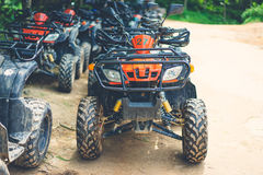 The red atv parking on dirt way Royalty Free Stock Photography