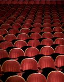 Red auditorium. Many rows of red auditorium chairs royalty free stock photo