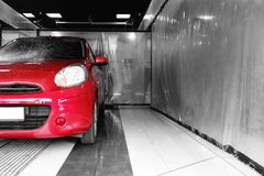 Red auto at car wash. stock photo
