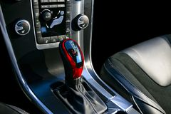 Red Automatic gear stick of a modern car, car interior details with electronic components. Royalty Free Stock Photos