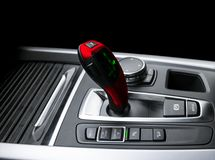 Red Automatic gear stick of a modern car. Modern car interior details. Close up view. Car detailing. Automatic transmission lever royalty free stock photos