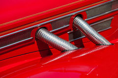 Red automobile exhaust system componen-corrugated Stock Image