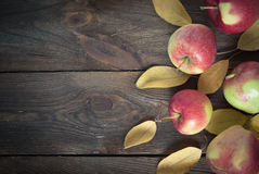 Red autumn Apples. With yellow leaves on a wooden table Stock Image