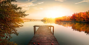Red autumn and fishing pier Royalty Free Stock Photos