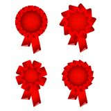 Red award ribbon rosette. Isolated on white Stock Image