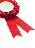 Red award ribbons badge. With white background Stock Photo