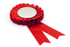 Red award ribbons badge. With white background Royalty Free Stock Photography