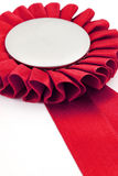 Red award ribbons badge. With white background Royalty Free Stock Photos