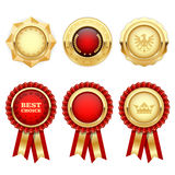 Red award rosettes and gold heraldic medals Stock Image