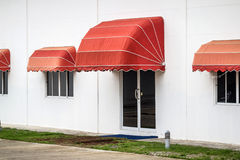 Red awning. Decorate on the building stock photography