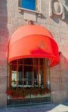 Red awning of Famous Astoria hotel at Bolshaya Morskaya street in St Petersburg, Russia -closeup street view Stock Image