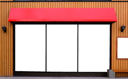 Red awning with wooden wall. With copy space stock photos