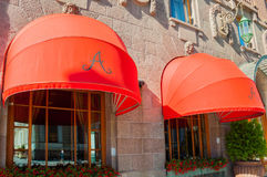 Red awnings of Famous Astoria hotel at Bolshaya Morskaya street in St Petersburg, Russia -closeup street view. ST PETERSBURG, RUSSIA - AUGUST 15, 2017. Red Stock Photo