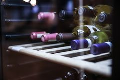 wine fridge with bottles stock photos