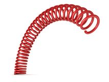 Red böjd fjäderspiral på vit bakgrund Royaltyfria Foton