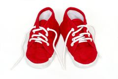 Red Baby Booties. A pair of red infant shoes royalty free stock photography