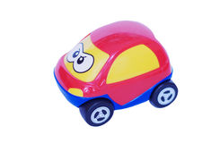 Red baby car on white background. Plastic red baby car on white background Royalty Free Stock Photo