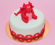 Red baby dragon birthday cake Stock Photos