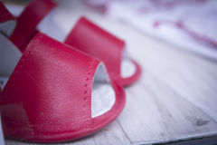 Red baby sandals. Closeup of red baby sandals Royalty Free Stock Photo