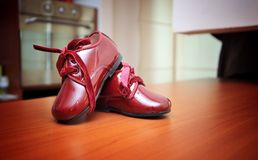 Red baby shoes. A red pair of a little baby shoes royalty free stock photography