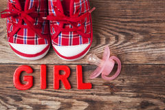Red baby shoes and pacifier Royalty Free Stock Image