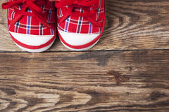 Red baby shoes and pacifier Royalty Free Stock Images
