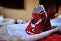 Red baby shoes. A red pair of a little baby shoes Royalty Free Stock Photo