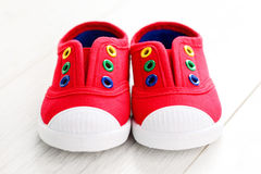 Red baby shoes. On white - baby stuff Stock Image