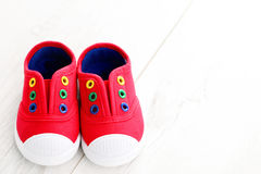 Red baby shoes Stock Photos