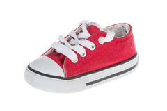 Red baby sneaker, isolated Royalty Free Stock Photography