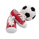 Red baby sneakers with a ball isolated Stock Photography