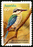 Red-Backed Kingfisher Australian Postage Stamp. AUSTRALIA - CIRCA 2010: A used postage stamp from Australia, depicting an illustration of a Red-Backed Kingfisher royalty free stock images