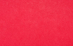Red background. Red texture of artifical leather Royalty Free Stock Photo