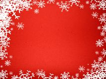 Red background. Red textured background with white snowflakes Stock Photography