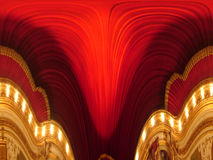Red background. Opera interior distorted in an mirror Stock Photography