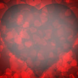 Red background blurred lights heart. Red background of blurred lights in the shape of a heart Stock Photos