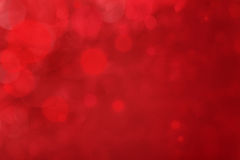 Red background with bokeh Stock Images