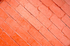 Red background of bricks on a diagonal image with a layer of pai Royalty Free Stock Photography