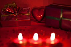 Red background with candles and heart Stock Photos